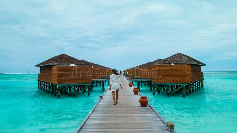 Maldives tropical Island, beautiful isolated luxury water bungalows Maldives in the blue green ocean of the maldives. Island stock photo