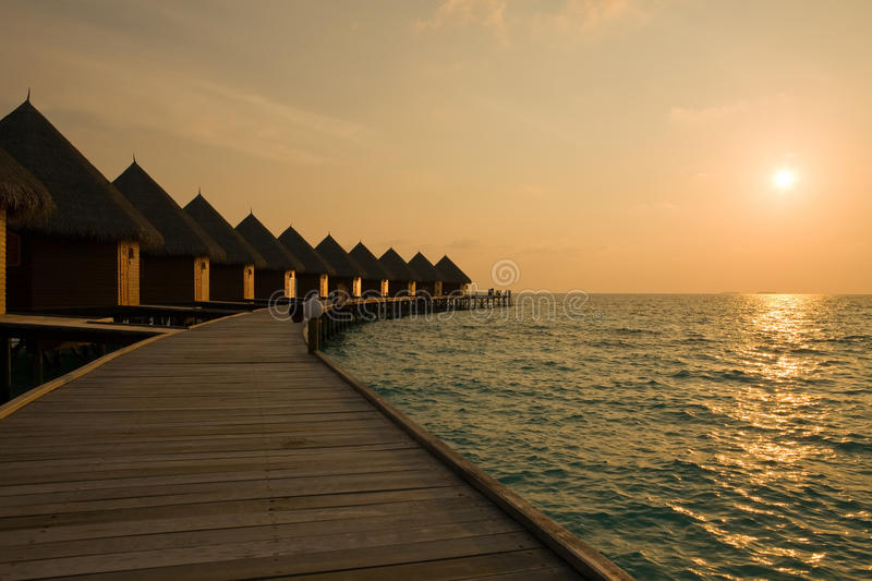 Maldives. Villa On Piles On Water At The Time Suns Stock Images