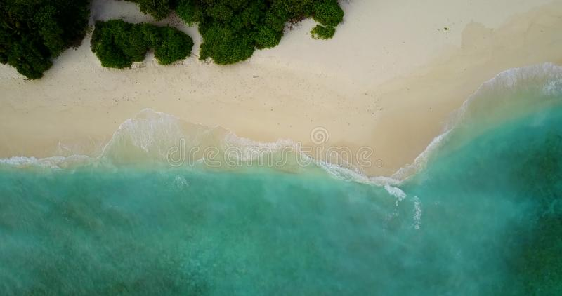 V10618 maldives white sand beach tropical islands with drone aerial flying view with aqua blue sea water and sunny sky. Maldives white sand beach tropical stock photo