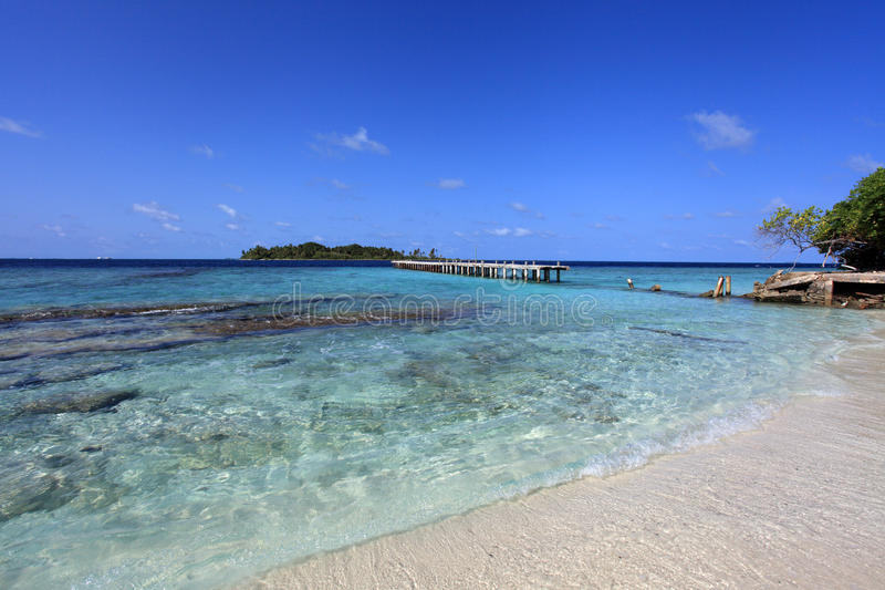 Maldivian island. Old jetty in the lagoon of maldivian island royalty free stock image