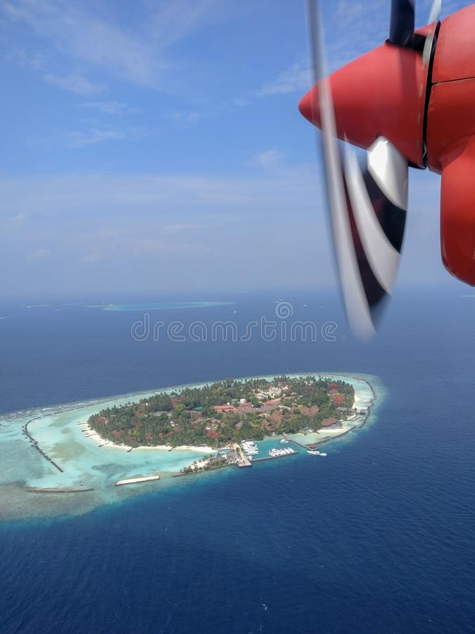 Maldivian island. View from a seaplane of a Maldivian exotic island royalty free stock image