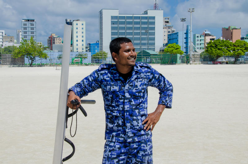 Maldivian police officer with shield and baton. Male. Maldives royalty free stock image