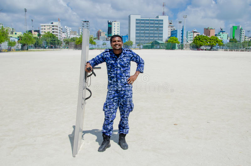 Maldivian police officer with shield and baton. Male. Maldives stock photos