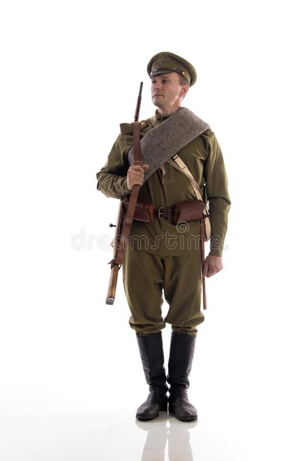 Male actor in the form of an ordinary soldier of the Russian army during the First World War posing against a white background in stock photos