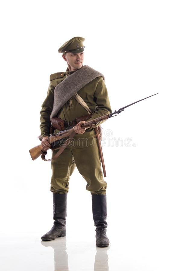 Male actor in the form of an ordinary soldier of the Russian army during the First World War posing against a white background in. Male actor in the form of an royalty free stock image