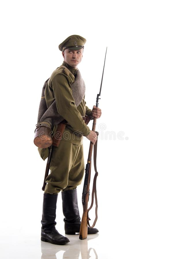 Male actor in the form of an ordinary soldier of the Russian army during the First World War posing against a white background in. Male actor in the form of an stock image