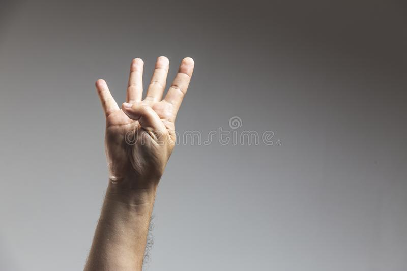 male adult hand showing number four gesture in studio shot isolated on white background stock images