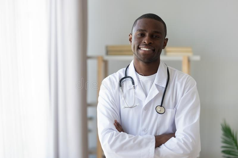 Male african american professional young doctor looking at camera, portrait stock image