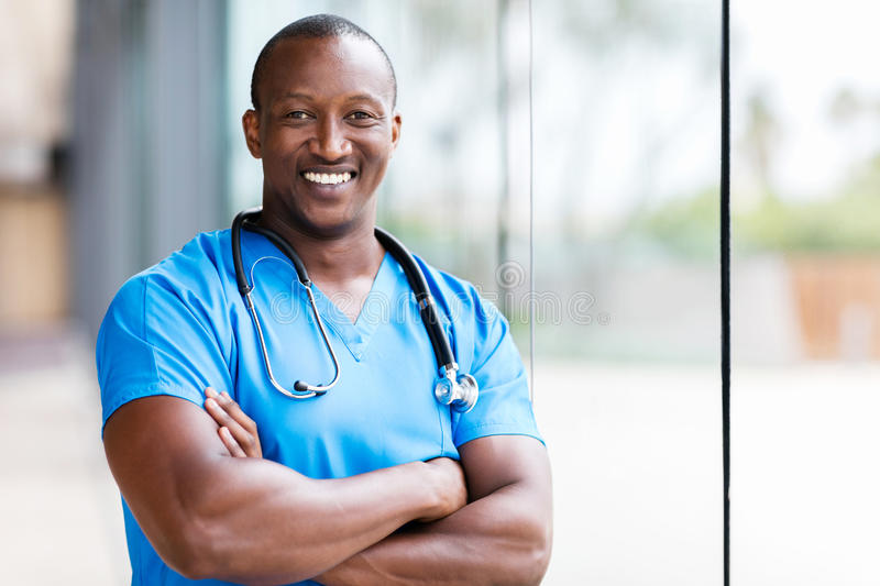 Male african medical surgeon. Happy male african medical surgeon looking at the camera stock photography