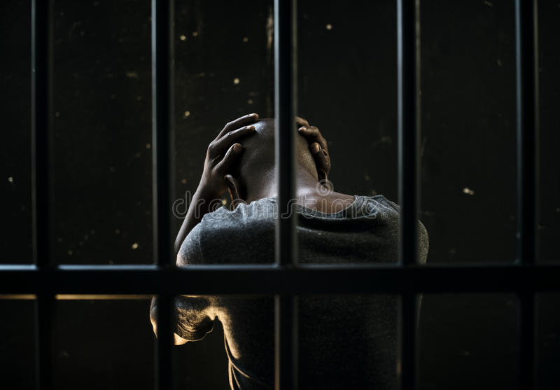 Male African In Prison Stressed Waiting royalty free stock images