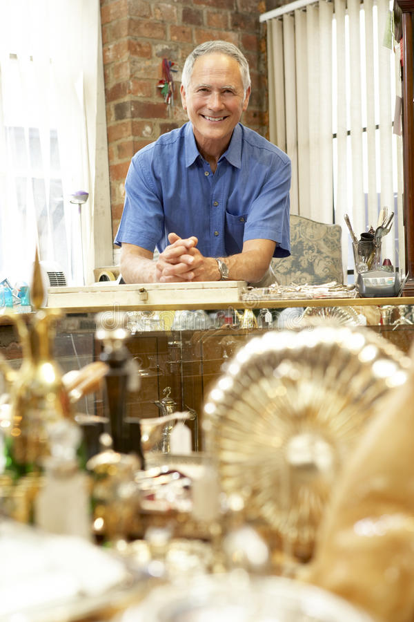 Male antique shop proprietor royalty free stock image