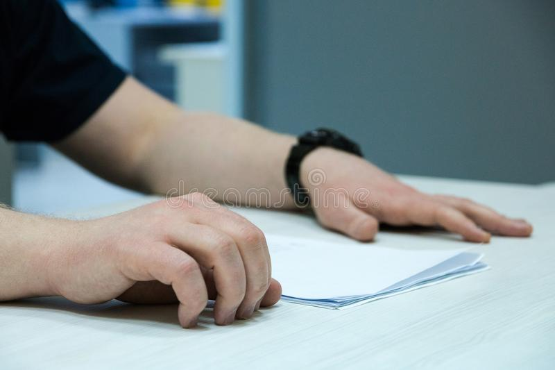 Male applicant having job interview, employers reading resume, asking question stock photo