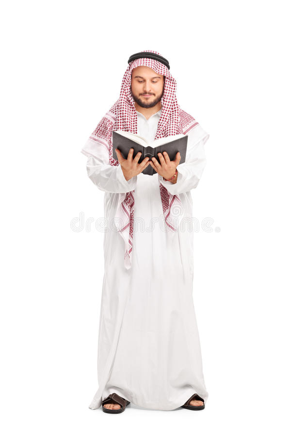 Male Arab in a white robe reading a book stock photography