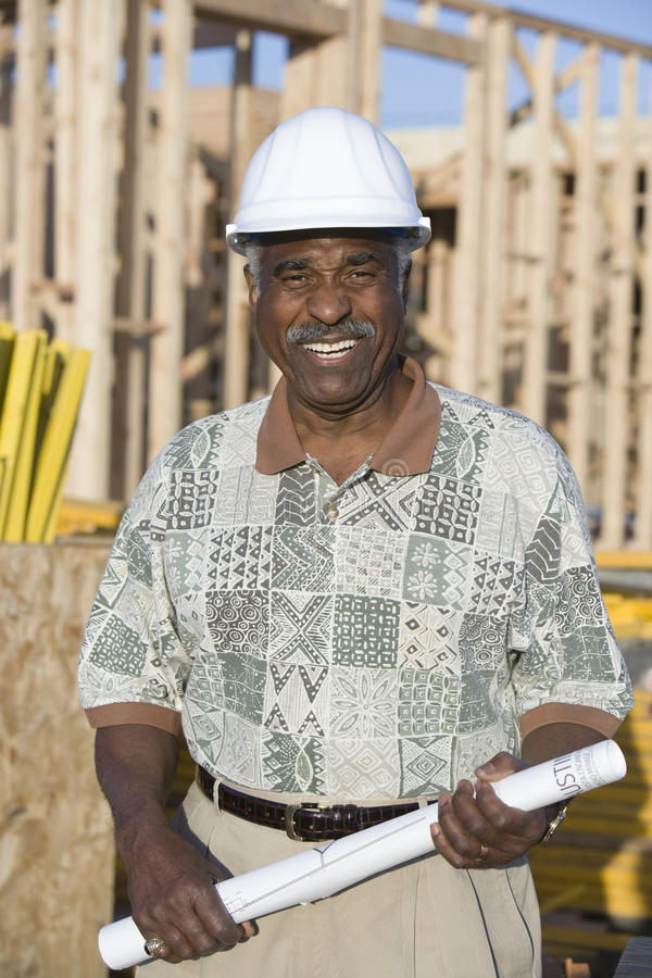 Download Male Architect With Blueprint At Construction Site Stock Photo - Image: 29654296
