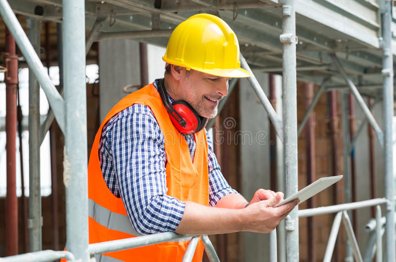 Male Architect Using Digital Tablet royalty free stock images