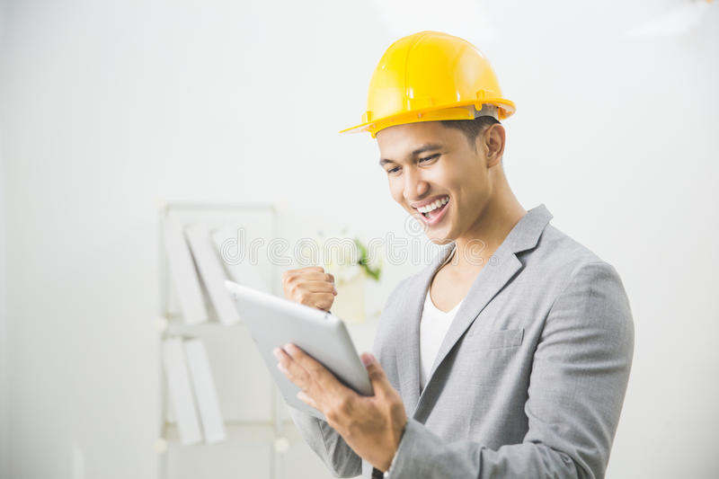 Male architect using digital tablet stock photos
