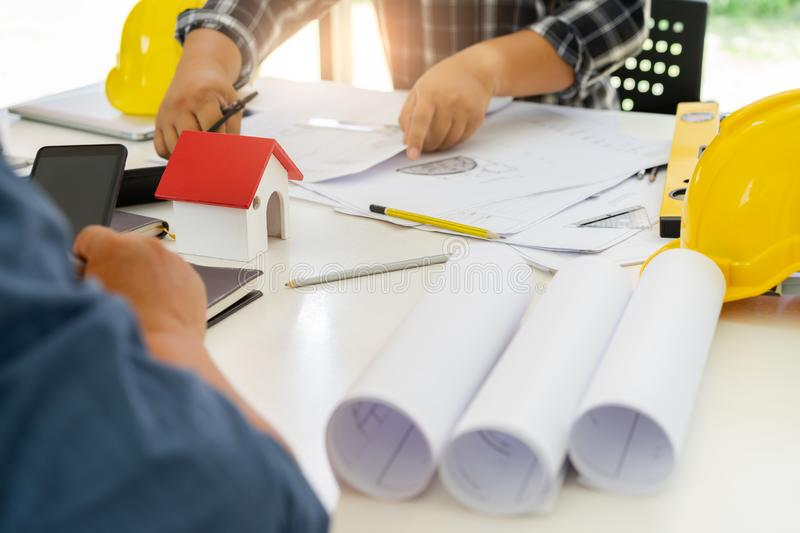 Male Architects designing,sketching the building royalty free stock images