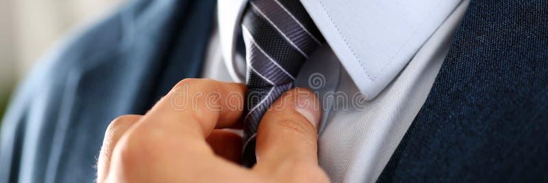 Male arm in blue suit set tie closeup stock photos