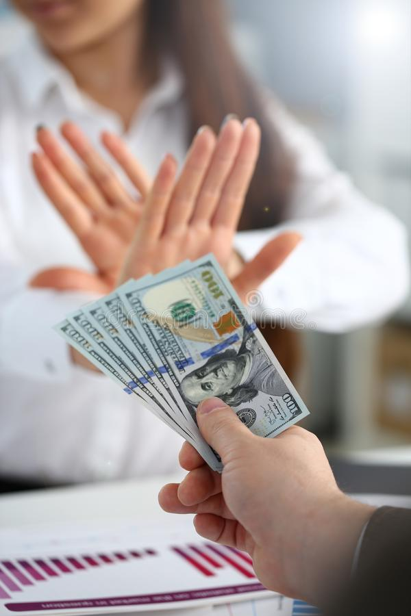 Male arm pay bunch of hundred dollars bills royalty free stock photo