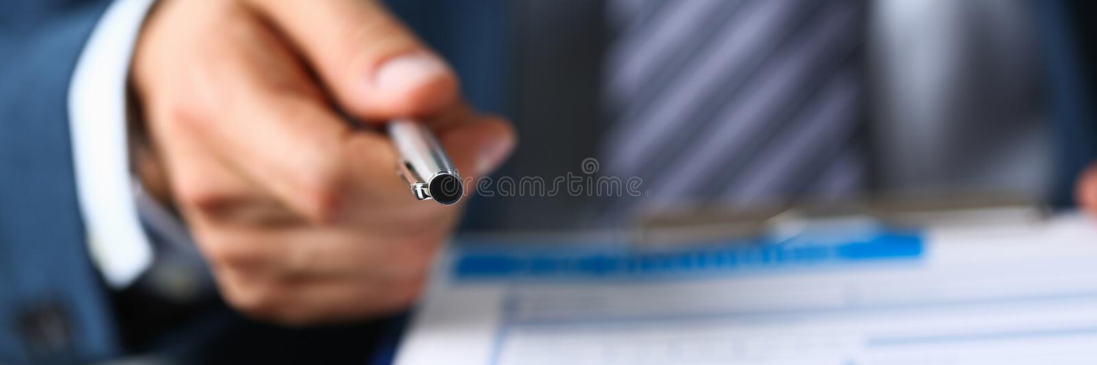 Male arm in suit offer contract form on stock image