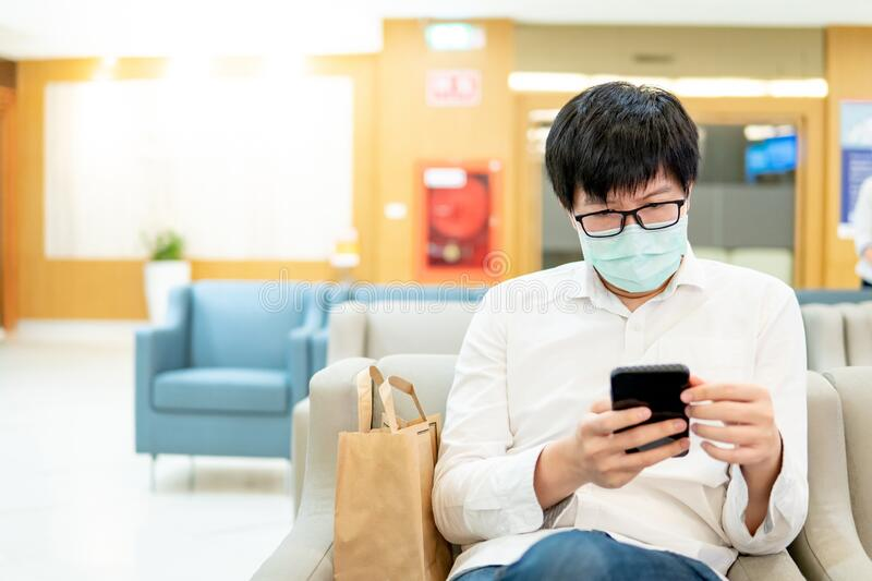 Male patient using smartphone in hospital stock photo