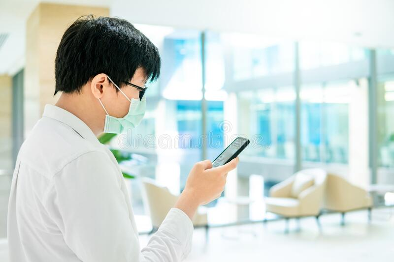 Male patient using smartphone in hospital stock images