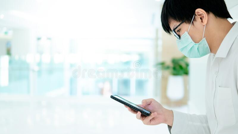 Male patient using smartphone in the hospital stock photo