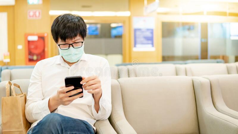 Male patient using smartphone in the hospital royalty free stock photo