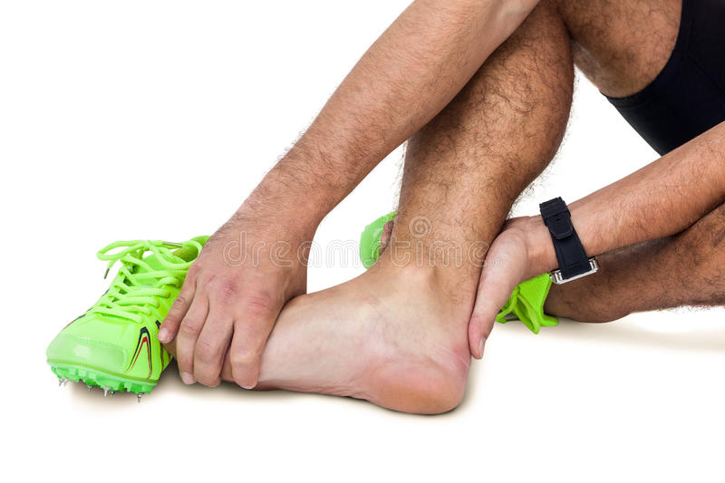 Male athlete with foot pain on white background. Male athlete with foot pain on isolated white background royalty free stock photos