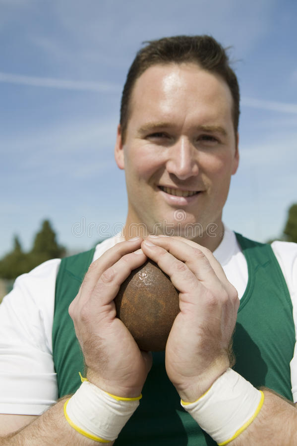 Male Athlete Holding Shot Put royalty free stock photography