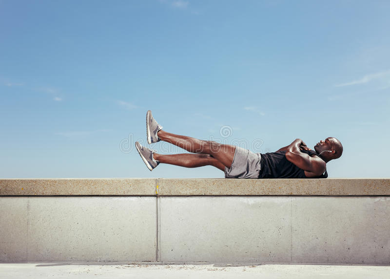 Male athlete making abdominals stock photography
