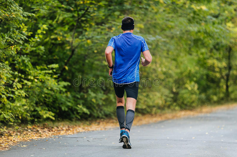 Male athlete of middle age running royalty free stock images