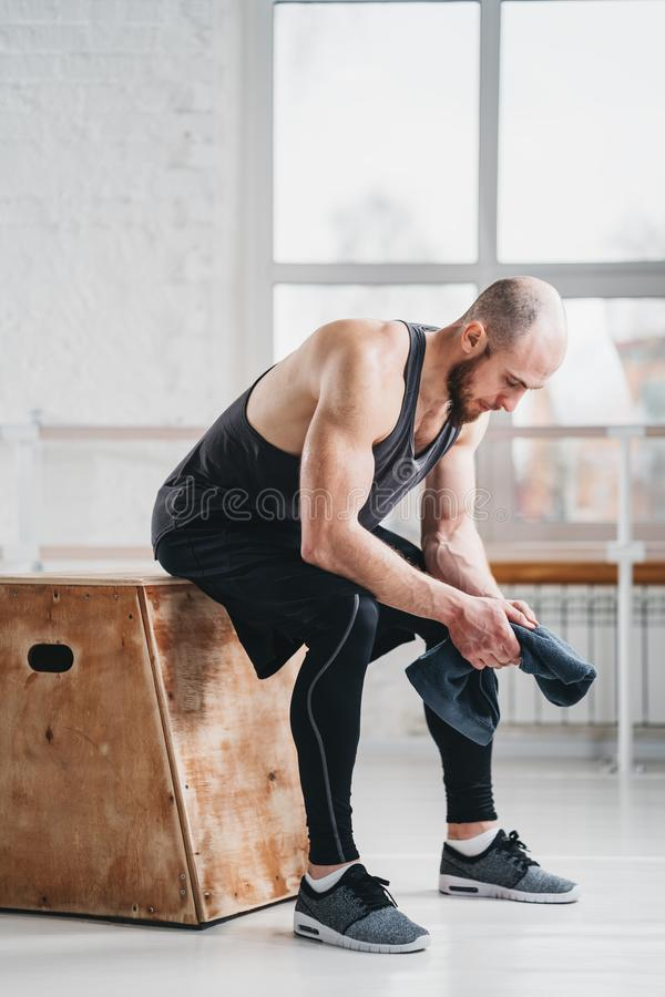 Male athlete relaxing after his intense workout at crossfit hall royalty free stock photo