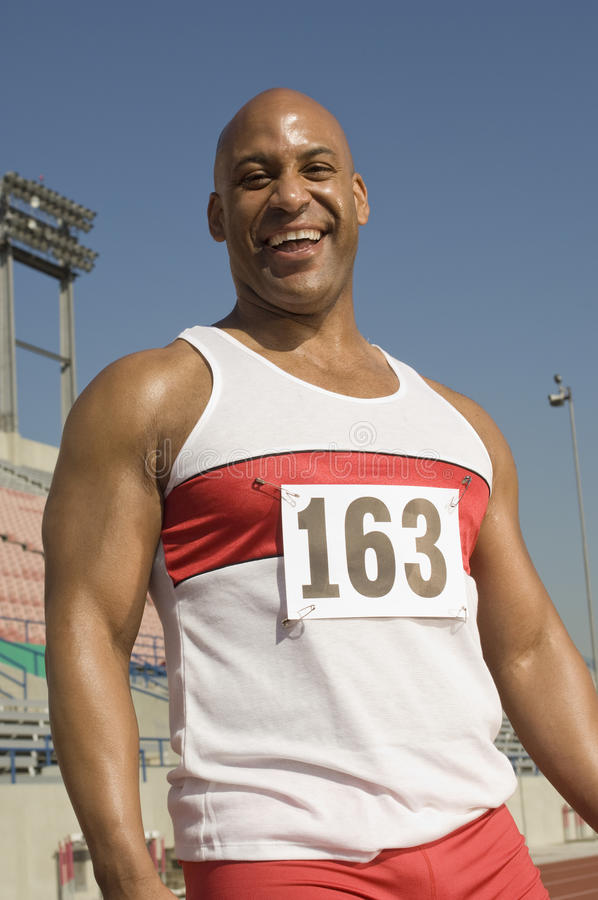 Male Athletes Stretching On Racetrack Stock Photo - Image Of Exercise, Male 29654952-7535