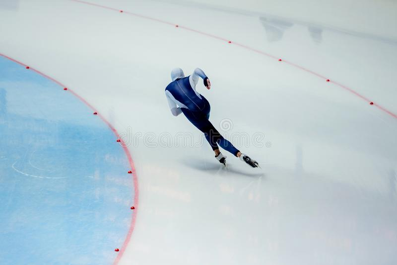 Male athlete speed skater. Skate turn in ice-skating stock photo