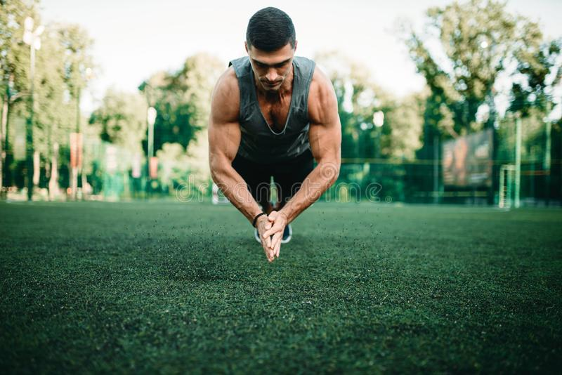 Athlete on training, push-up exercise in action royalty free stock photos