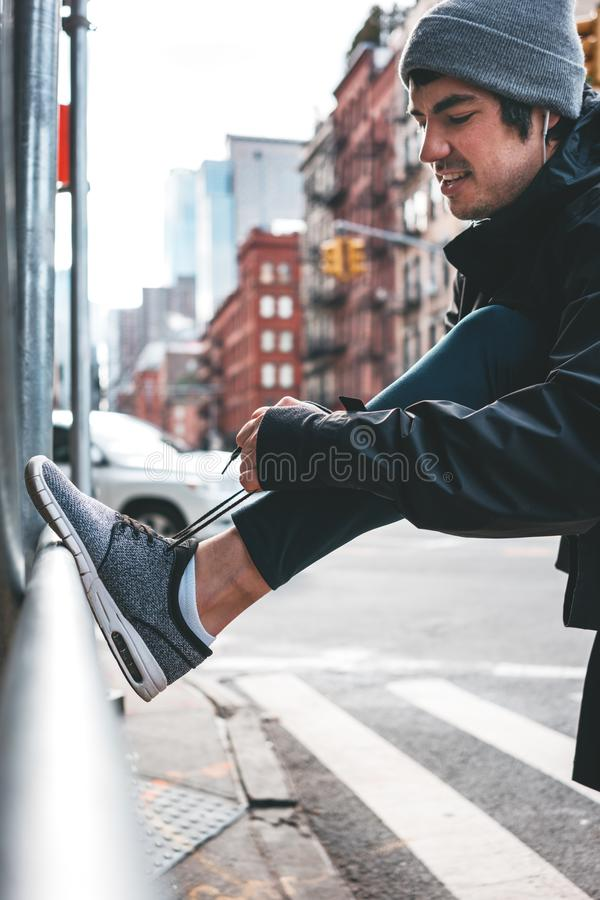 Male athlete warming up and training in big city stock photos