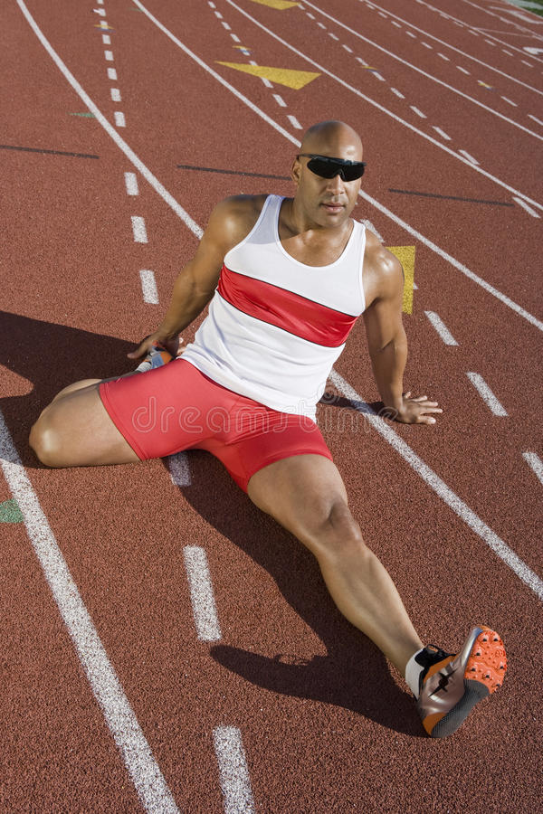 Male Athlete Working Out Before Race stock photo