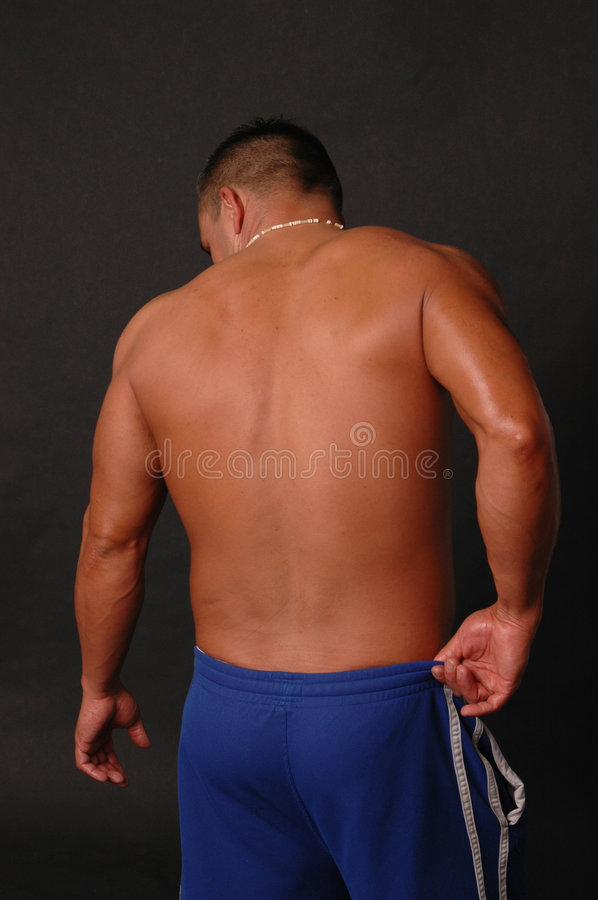 Male back in blue sweats royalty free stock images