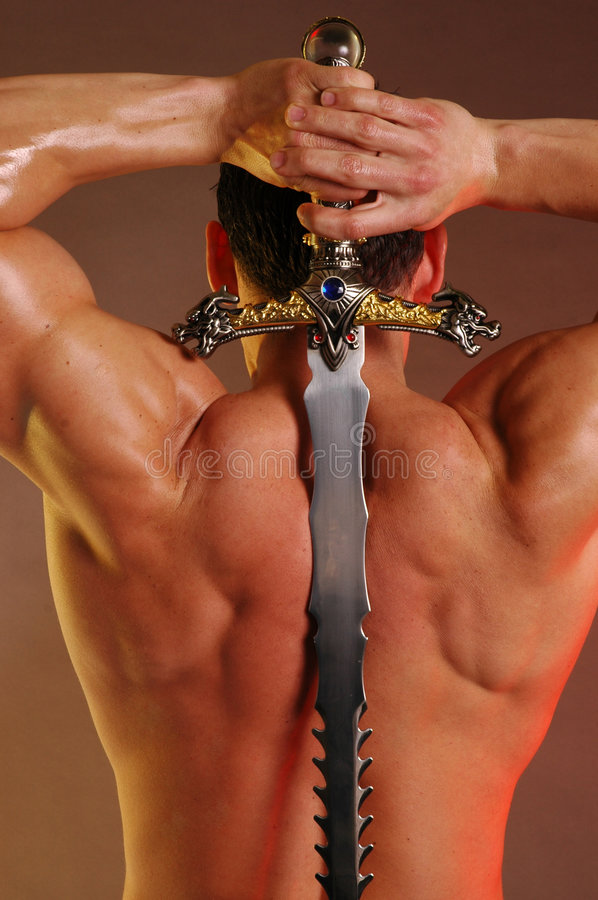Male back with sword stock photos