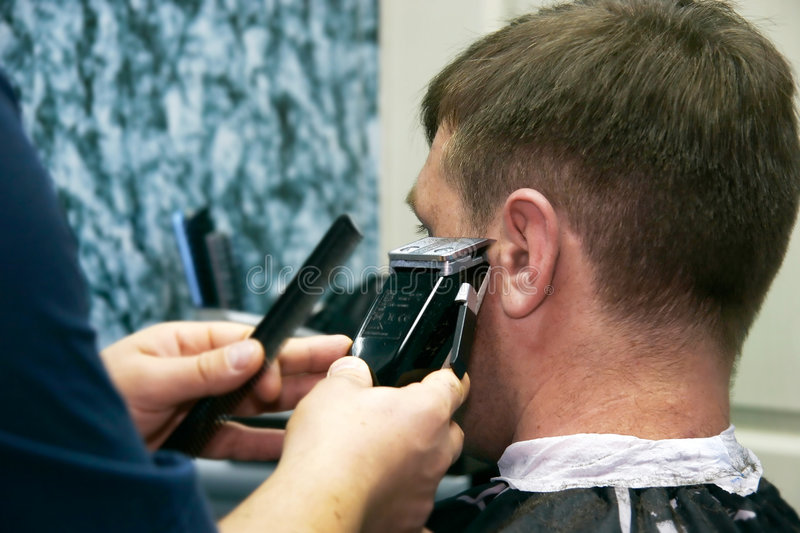 Male barber at work stock images