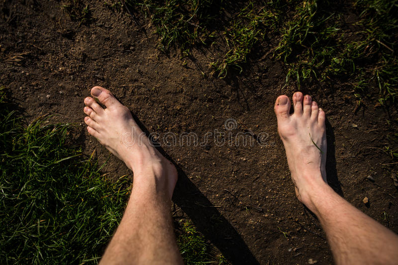 Male bare feet on the way stock images