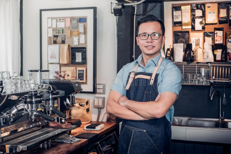 Male Barista cafe owner cross arms in store counter bar inside c stock images