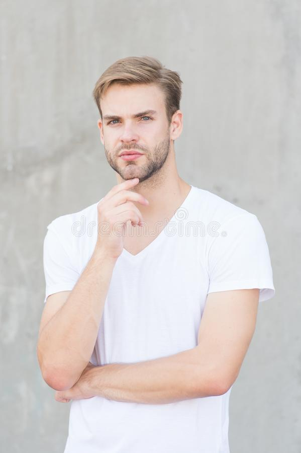 Male beauty standards. Handsome man unshaven face stylish hairstyle. Handsome caucasian man gray background. Ideal stock images
