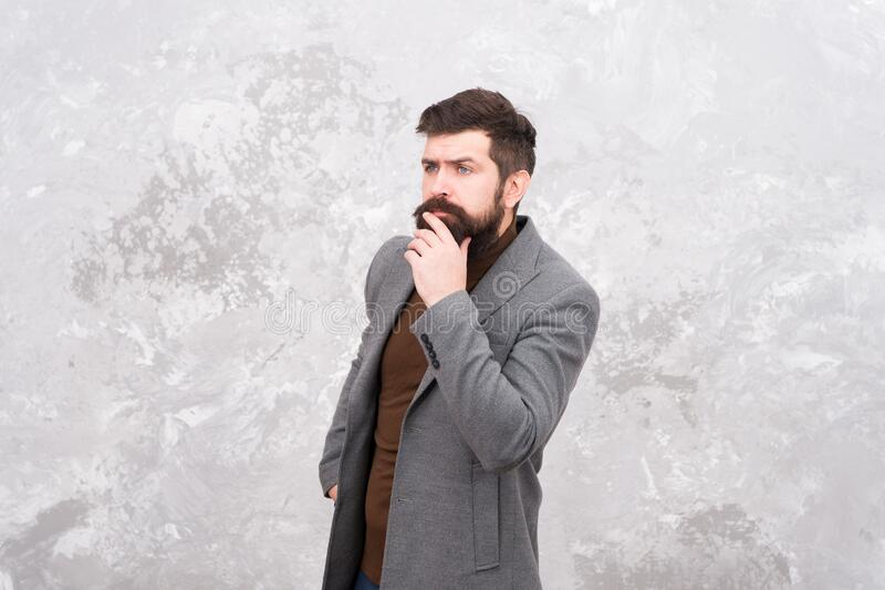 Male beauty standards. Menswear concept. Elegant and stylish hipster. Bearded man thinking outdoor. man autumn style. Casual business attire. Fashion style and stock photo