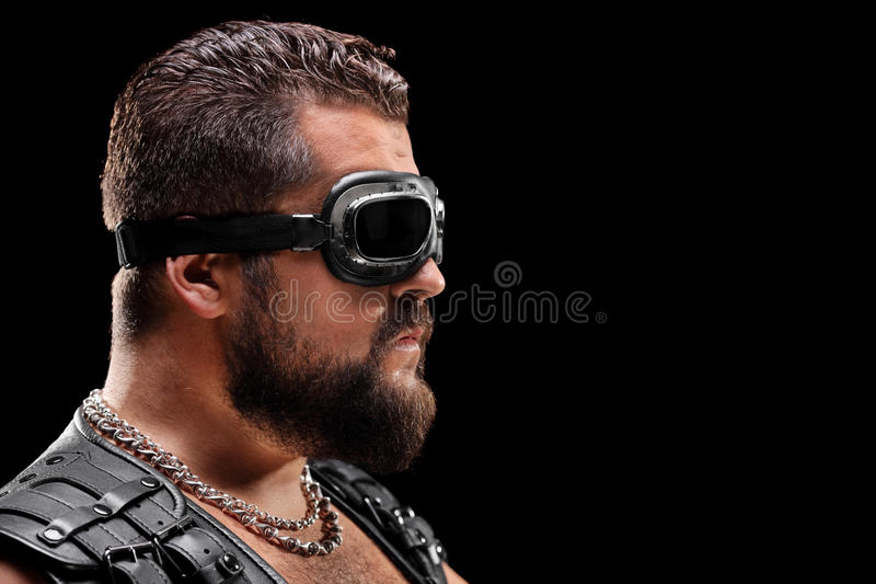 Male biker with goggles. On black background royalty free stock images