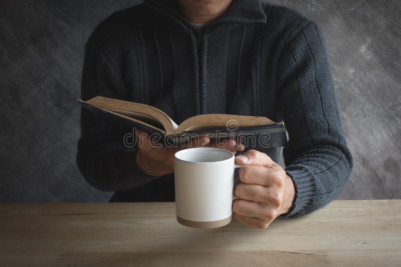 Male Black Coffee cup paper Reading on a wooden table stock images