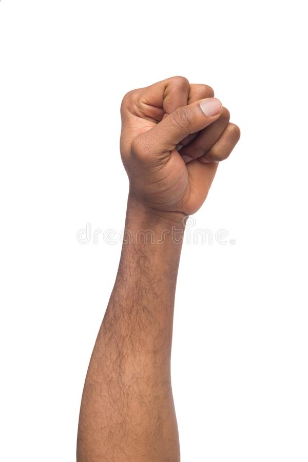 Male black fist isolated on white background. African-american clenched hand, gesturing up. Counting, aggression, brave, masculinity concept royalty free stock photos