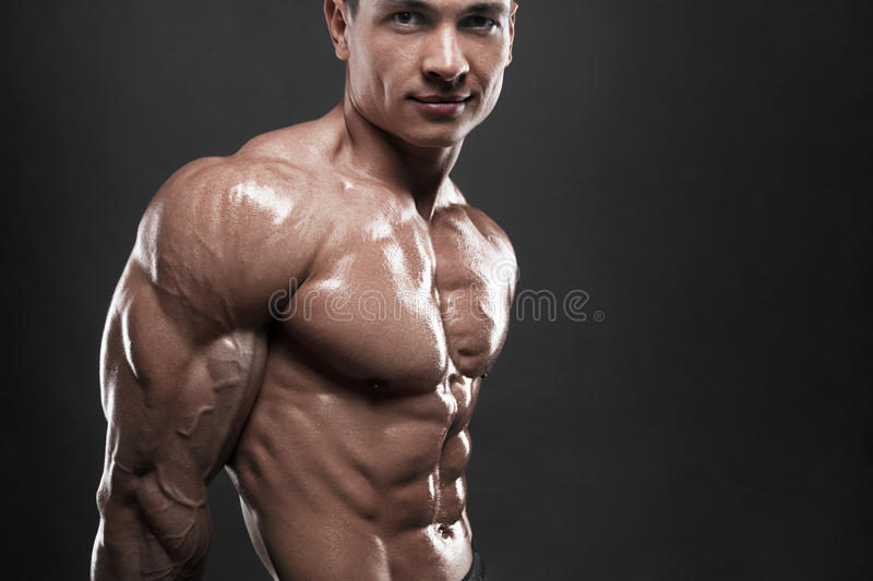 The male body on black background. stock photography