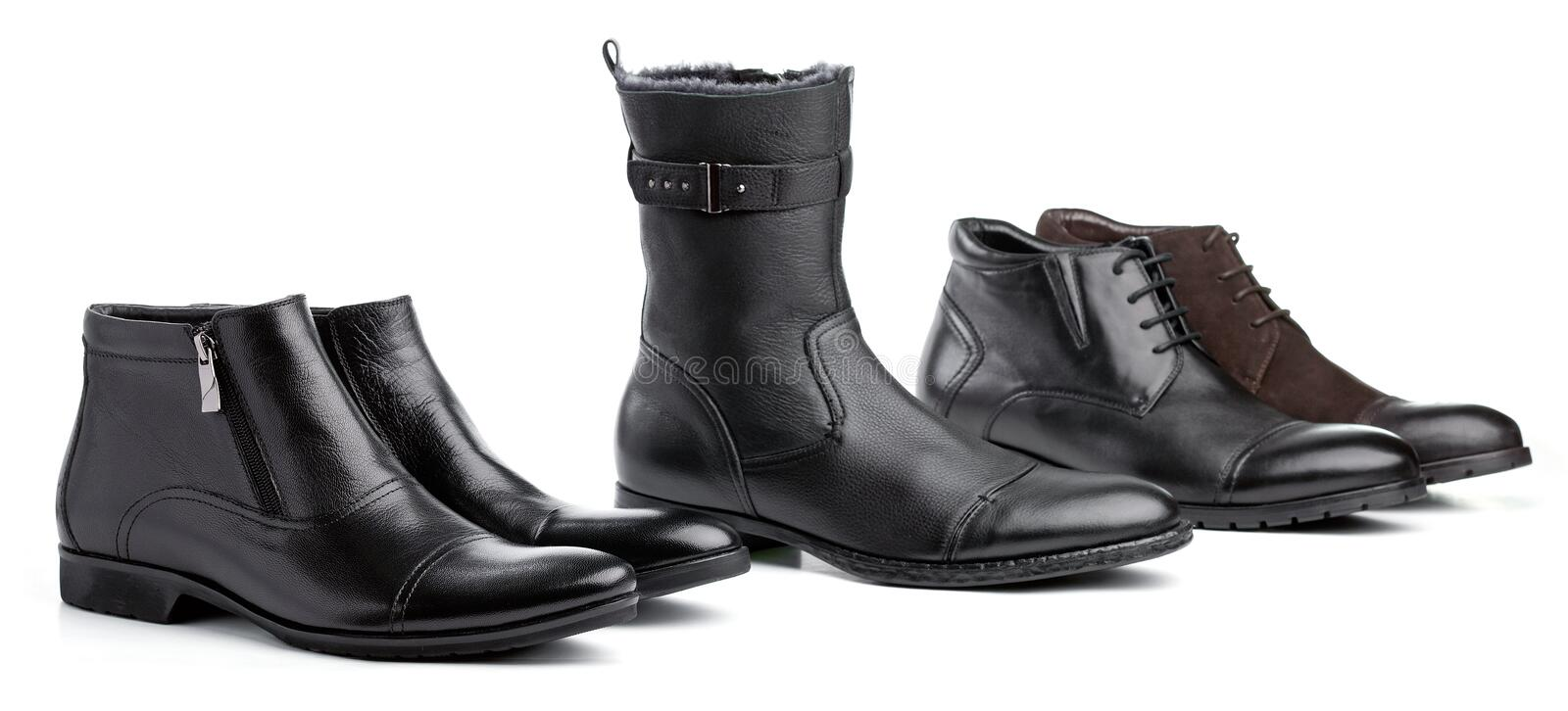 Male boots over white, all boots different royalty free stock image